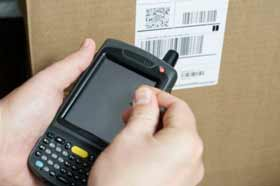 This is a picture of taking inventory with a haldheld computer barcode scanner.